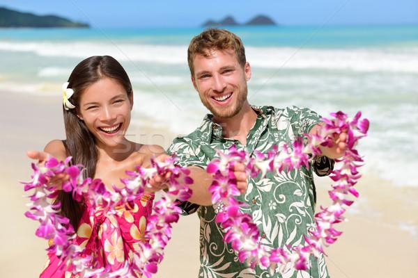 Welcome to Hawaii - Hawaiian people showing lei Stock photo © Maridav