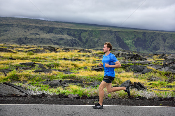 Athlete male runner running on mountain road Stock photo © Maridav