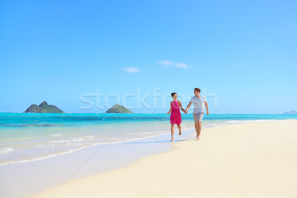Beach couple happy having fun on Hawaii honeymoon Stock photo © Maridav