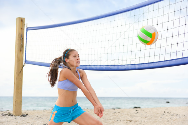 Beach volleyball woman playing game hitting ball Stock photo © Maridav