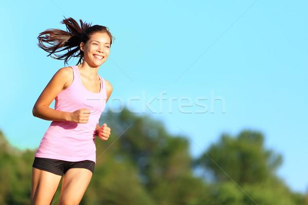 Happy woman running Stock photo © Maridav