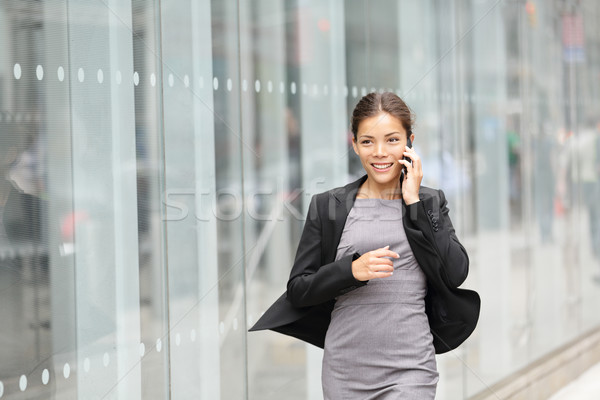 Business woman in motion Stock photo © Maridav