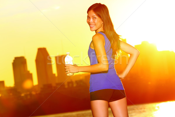 Woman Runner drinking water city running, Montreal Stock photo © Maridav