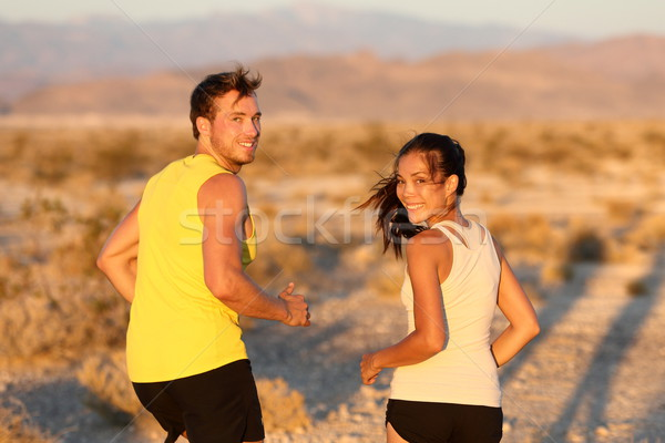 Exercise - couple running looking happy Stock photo © Maridav