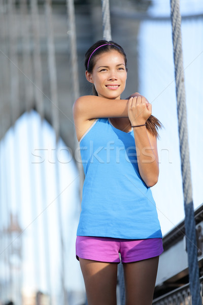 Athlete runner stretching running, Brooklyn Bridge Stock photo © Maridav