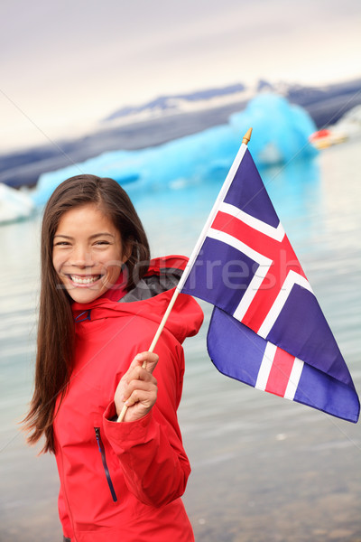 Iceland - girl holding Icelandic flag at glacier Stock photo © Maridav