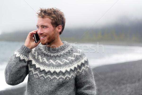 Smart phone man talking on phone on beach, Iceland Stock photo © Maridav
