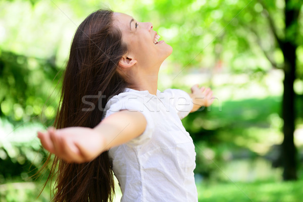 Joyful Woman With Arms Outstretched In Park Stock photo © Maridav