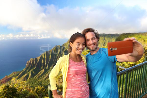 Happy interracial couple - hawaii travel selfie Stock photo © Maridav