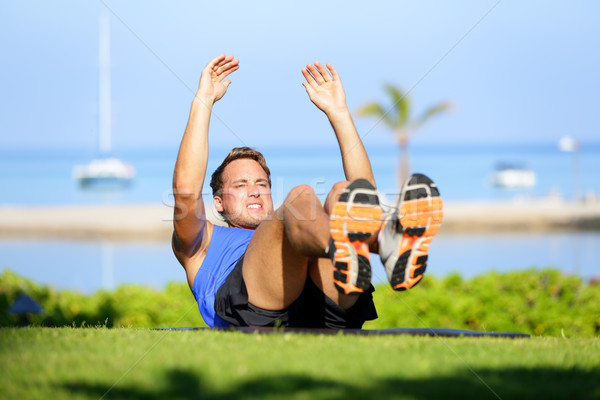 Stock photo: Fitness man doing sit-ups exercise for abs