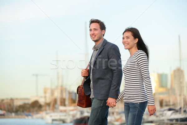 Young couple walking outdoors in city harbor Stock photo © Maridav