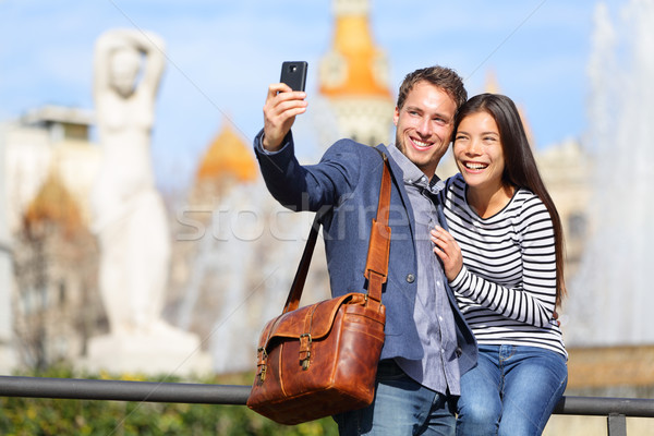 Happy urban city couple on travel in Barcelona Stock photo © Maridav