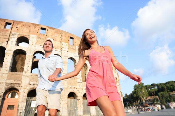 Utazás pár Róma Colosseum fut jókedv Stock fotó © Maridav