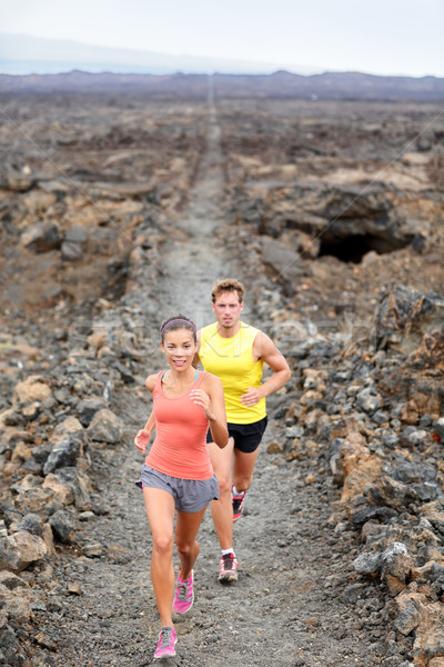 Stock photo: Cross country running woman and man trail runners