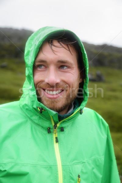 Regen jas man glimlachend buitenshuis regenachtig Stockfoto © Maridav