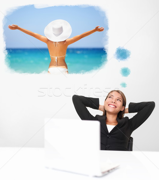 Smiling businesswoman dreaming of the beach travel Stock photo © Maridav