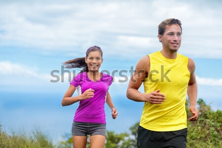 Couple athletes trail running together in nature Stock photo © Maridav