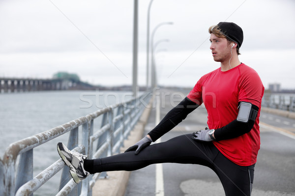 Winter fitness running man warm-up stretching legs Stock photo © Maridav
