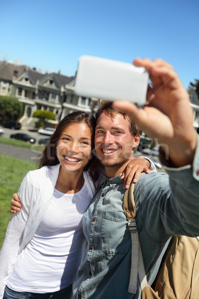 Couple fun taking self-portrait in San Francisco Stock photo © Maridav