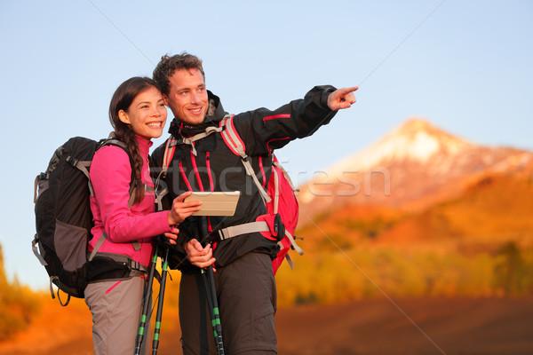 Tablet PC - hiking couple using travel app Stock photo © Maridav