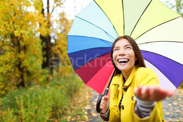 Umbrella woman in Autumn excited under rain Stock photo © Maridav