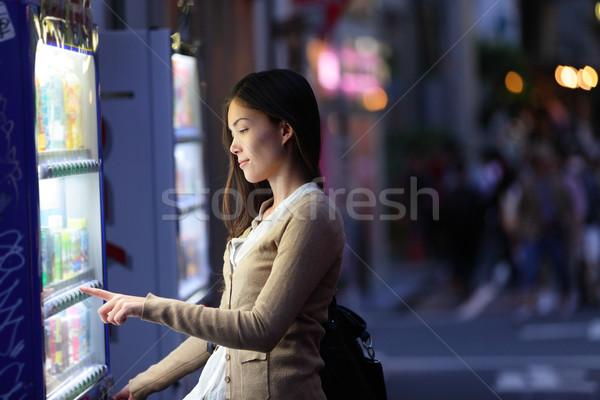 Japan vending machines - Tokyo woman buying drinks Stock photo © Maridav