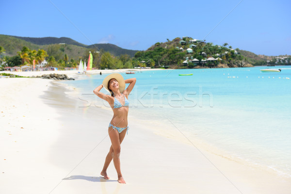Happy beach woman in bikini on Jolly Beach Antigua Stock photo © Maridav