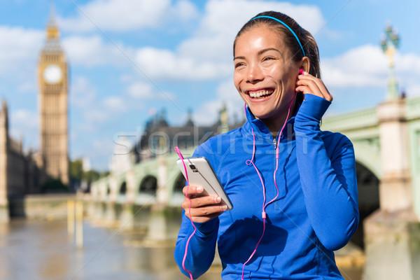 London running girl listening to smartphone music Stock photo © Maridav