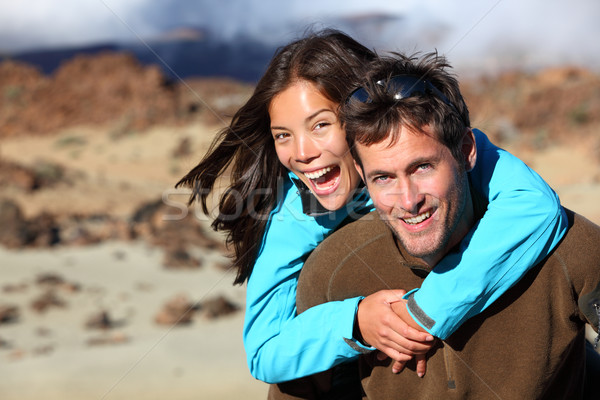 Happy young couple smiling outdoors Stock photo © Maridav