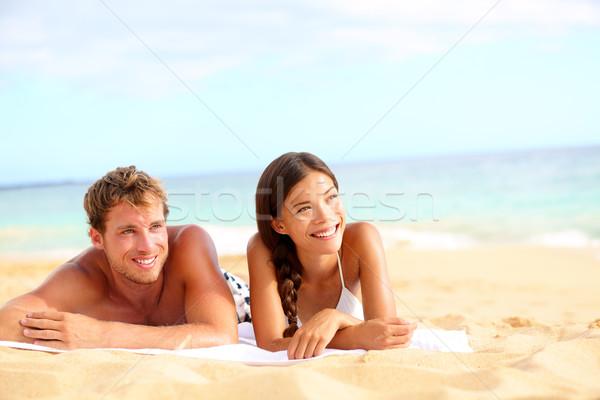 Couple on beach looking happy Stock photo © Maridav