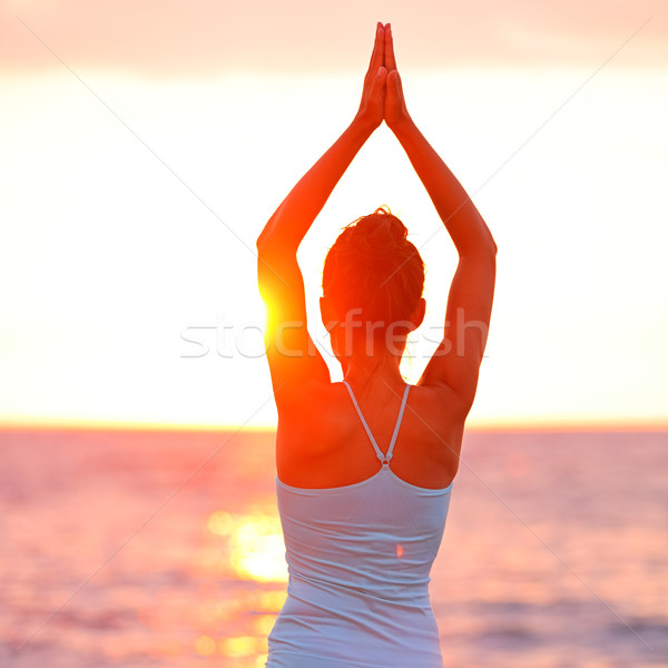 Meditation Yoga woman meditating at beach sunset Stock photo © Maridav