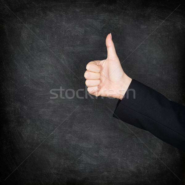 Thumbs up hand on blackboard / chalkboard Stock photo © Maridav
