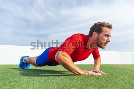 Push ups - fitness man exercising push up outside Stock photo © Maridav