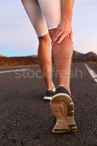 Cramps in leg calves or sprain calf on runner Stock photo © Maridav