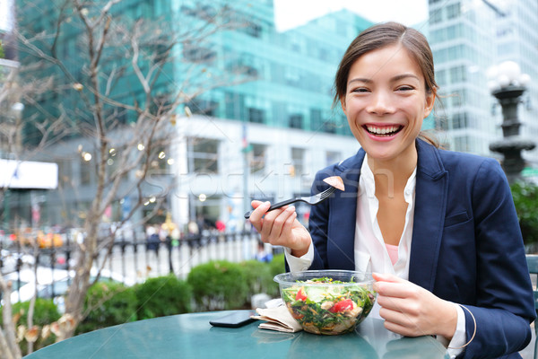 Business woman eating salad on lunch break Stock photo © Maridav