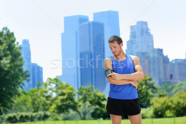 New York City runner listening music on smartphone Stock photo © Maridav