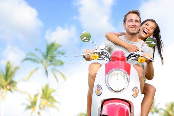 Stock photo: Free young couple on scooter on summer vacation