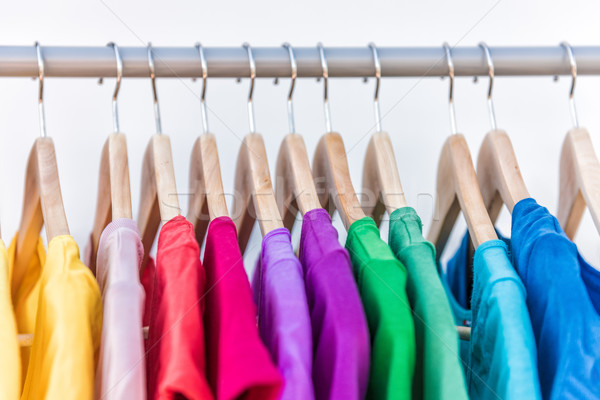 Fashion clothes on clothing rack colorful closet Stock photo © Maridav