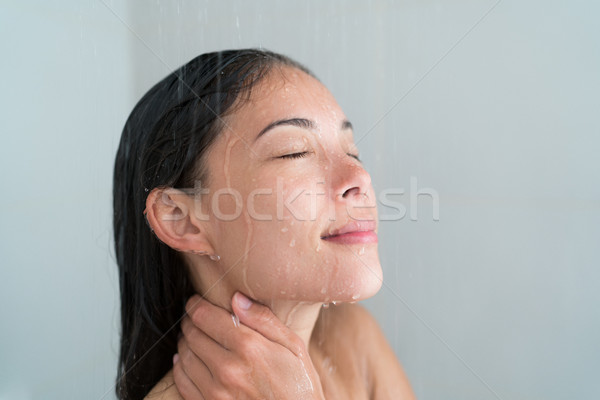 Shower woman showering relaxing washing face Stock photo © Maridav