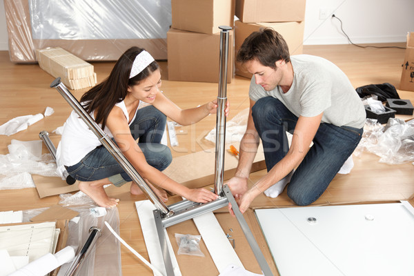 Couple moving in together assembling furniture table Stock photo © Maridav
