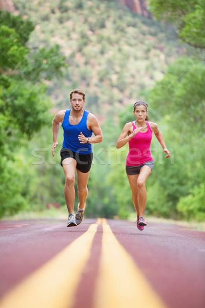 Sprinting running couple on road exercising sport Stock photo © Maridav