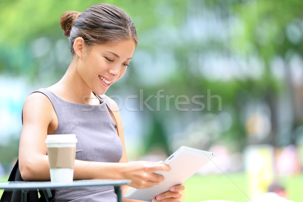 Business woman using tablet on break Stock photo © Maridav