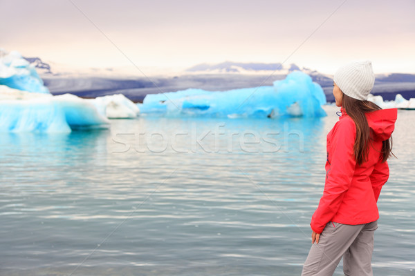 Iceland glacial lagoon - woman looking at view Stock photo © Maridav