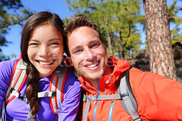 Selfie couple taking self-portrait hiking candid Stock photo © Maridav