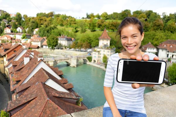 Woman showing smart phone app in Bern Switzerland Stock photo © Maridav