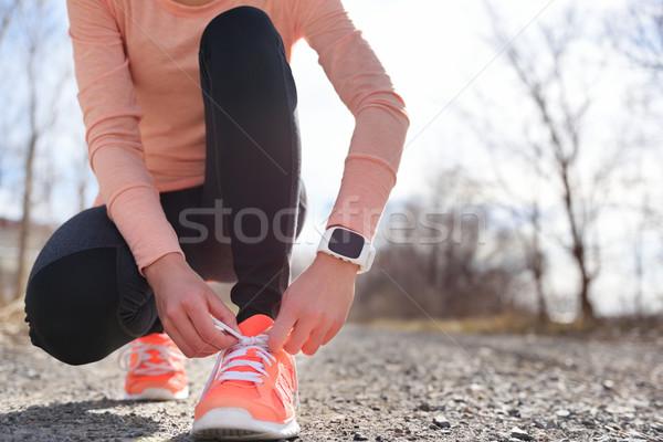 Running shoes and runner sports smartwatch Stock photo © Maridav