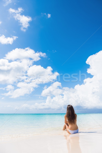 Beach woman enjoying serene luxury vacation sun Stock photo © Maridav