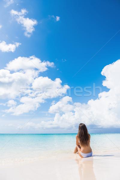Stock photo: Beach woman enjoying serene luxury vacation sun