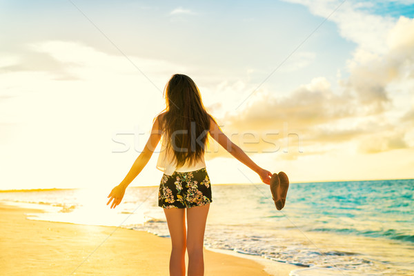 Freedom woman carefree dancing relaxing on beach  Stock photo © Maridav