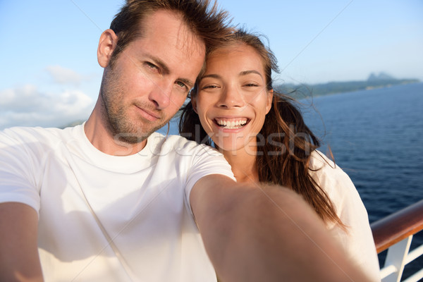 Selfie couple taking holiday picture of themselves Stock photo © Maridav